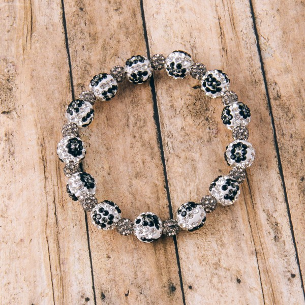 "Black and white rhinestone leopard print stretch bracelet.  - Approximately 3"" in diameter unstretched - Fits up to a 6"" wrist"