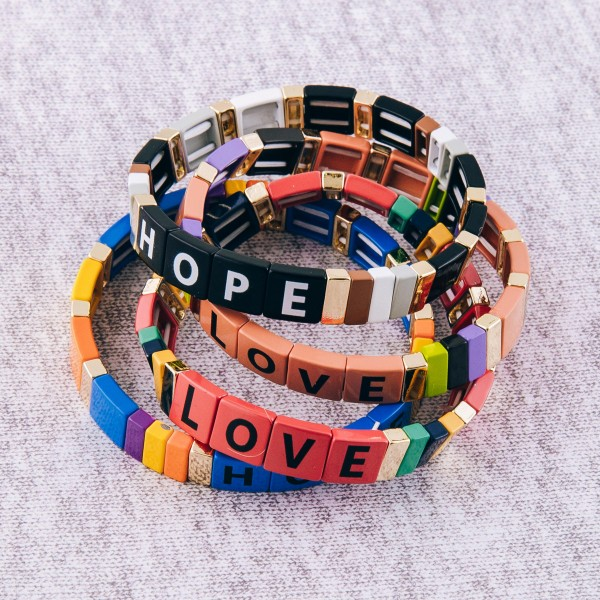 """Inspirational shiny enamel coated """"Love"""" letter color block stretch bracelet.  - Approximately 3"""" in diameter unstretched - Fits up to a 7"""" wrist"""