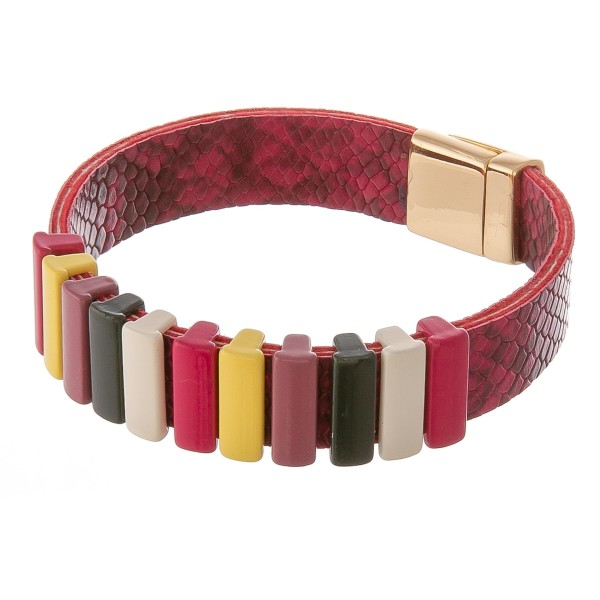 "Faux leather snakeskin color block magnetic bracelet.  - Magnetic clasp - Approximately 3"" in diameter - Fits up to a 6"" wrist"
