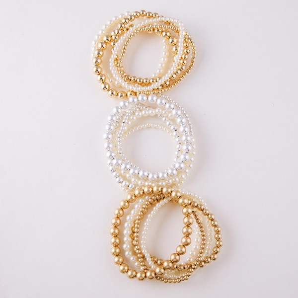 "Faux pearl beaded sphere stretch bracelet set.  - 5pcs/set - Approximately 3"" in diameter unstretched - Fits up to a 6"" wrist"