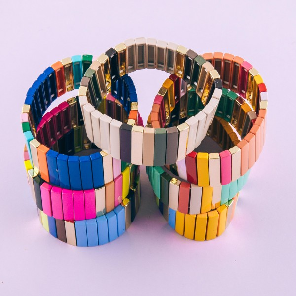 """Shiny enamel coated pinstripe color block stretch bracelet.  - Approximately 3"""" in diameter unstretched - Fits up to a 7"""" wrist  - .75"""" in width"""