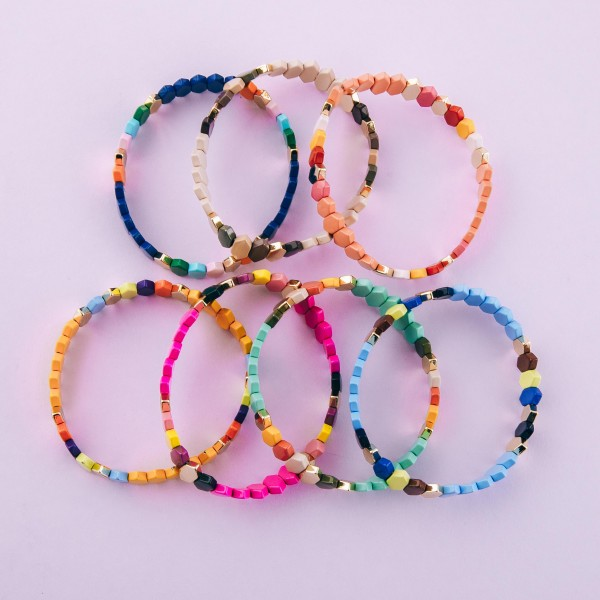 """Shiny enamel coated beveled hexagon color block stretch bracelet.  - Approximately 3"""" in diameter unstretched - Fits up to a 7"""" wrist"""