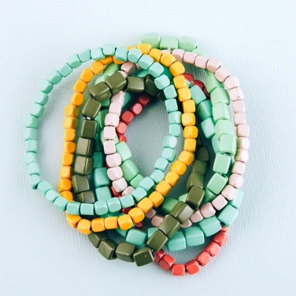 """Heavyweight shiny enamel coated multi color block beaded stretch bracelet set.  - 7 pcs/pack - Approximately 3"""" in diameter unstretched - Fits up to a 7"""" wrist"""