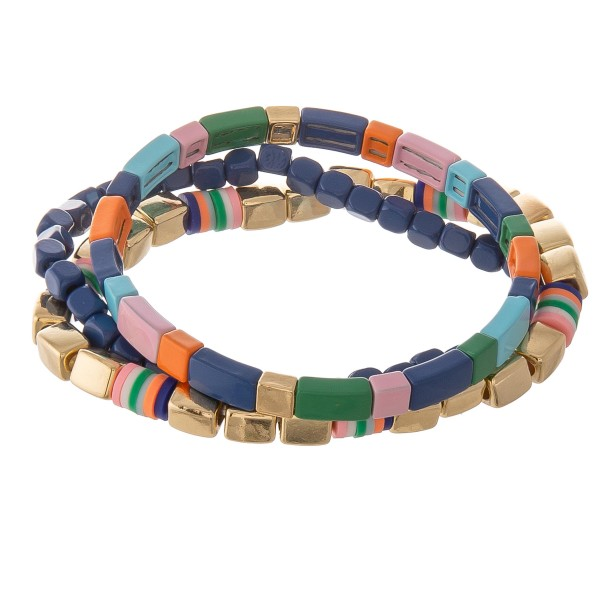"Gold shiny enamel coated multi color block stretch bracelet set.  - 3 pcs/pack - Approximately 3"" in diameter unstretched - Fits up to a 7"" wrist"