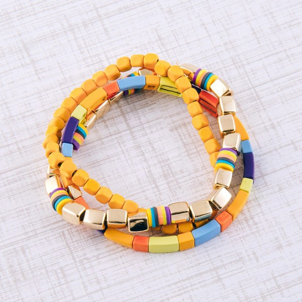 """Gold shiny enamel coated multi color block stretch bracelet set.  - 3 pcs/pack - Approximately 3"""" in diameter unstretched - Fits up to a 7"""" wrist"""