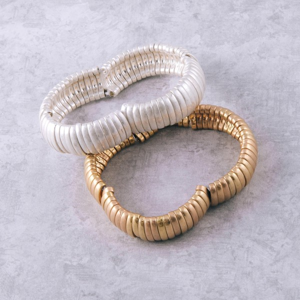"""Metal bar stretch bracelet.  - Approximately 3"""" in diameter unstretched - Fits up to a 6"""" wrist - Bracelet width approximately .5"""""""