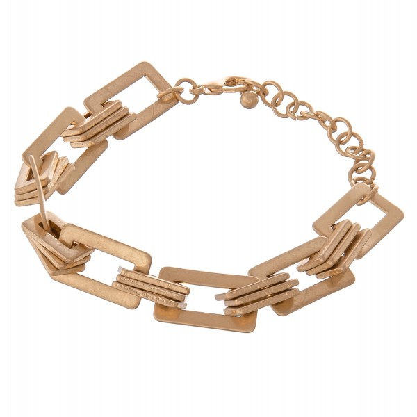 "Square chain linked metal bracelet with adjustable extender.  - Lobster clasp closure - Adjustable 2"" extender - Approximately 3"" in diameter - Fits up to an 8"" wrist"