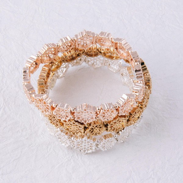 """Filigree flower stretch bracelet.  - Approximately 3"""" in diameter unstretched  - Fits up to a 6"""" wrist"""