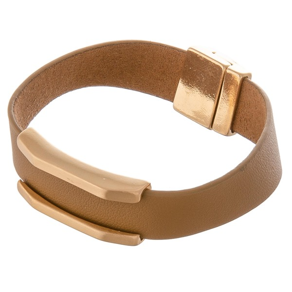 "Faux leather magnetic bracelet with gold metal accent.  - Magnetic closure - Approximately 3"" in diameter - Fits up to a 6"" wrist"