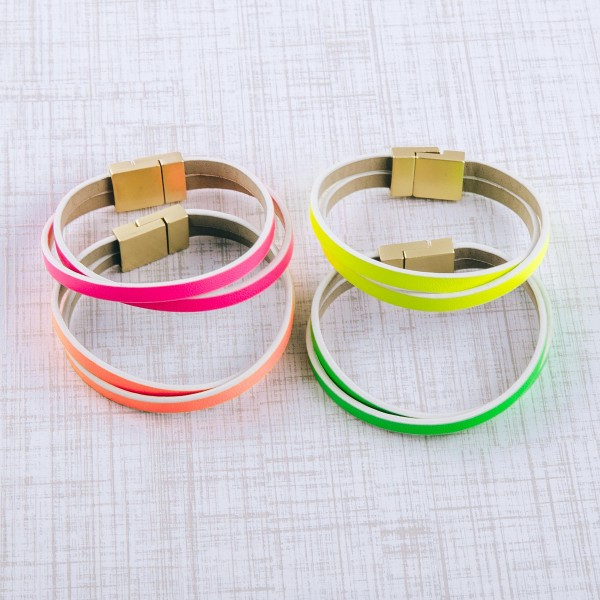"Neon faux leather double strand twisted magnetic bracelet.  - Magnetic closure - Approximately 3"" in diameter - Fits up to a 6"" wrist"