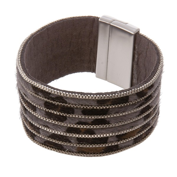 "Leopard print cowhide metal striped magnetic bracelet.  - Faux leather - Magnetic closure - Approximately 3"" in diameter - Fits up to a 6"" wrist"