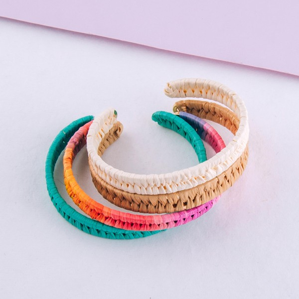 """Raffia woven cuff bracelet.  - Approximately 2.5"""" in diameter - Fits up to a 5"""" wrist"""