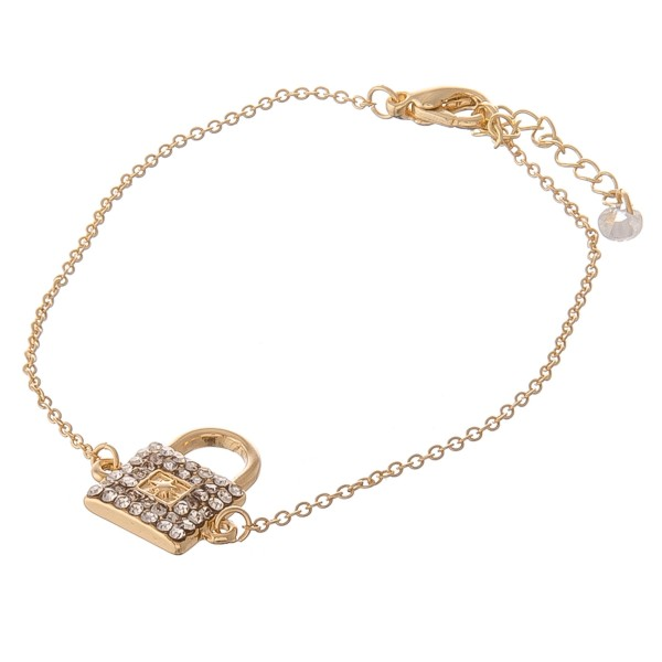 """Dainty gold rhinestone lock bracelet with lobster clasp closure.  - Adjustable 1.5"""" lobster clasp - Focal approximately .5""""  - Approximately 3"""" in diameter - Fits up to a 7"""" wrist"""