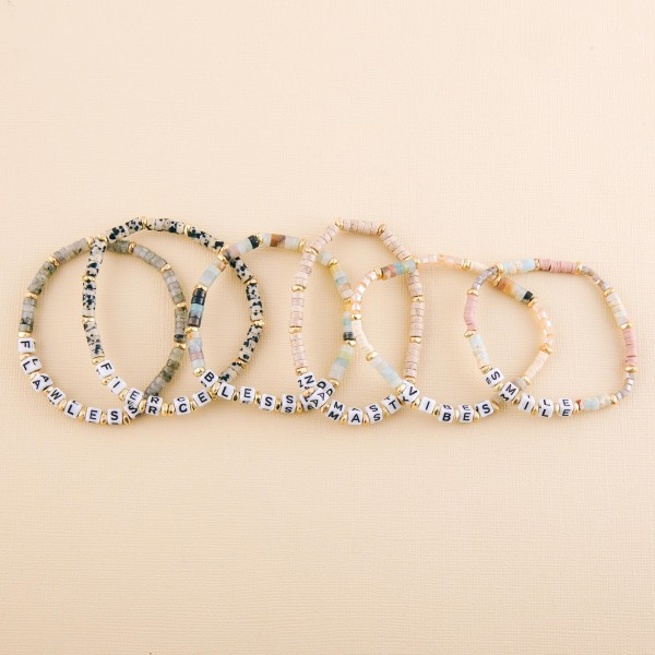 "Semi precious beaded ""Blessed"" letter stretch bracelet.  - Approximately 3"" in diameter unstretched - Fits up to a 7"" wrist"