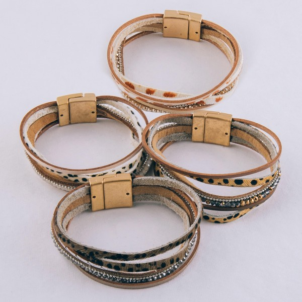 """Multi strand genuine leather cheetah print magnetic bracelet with beaded details.  - Magnetic closure - Approximately 3"""" in diameter - Fits up to a 6"""" wrist"""