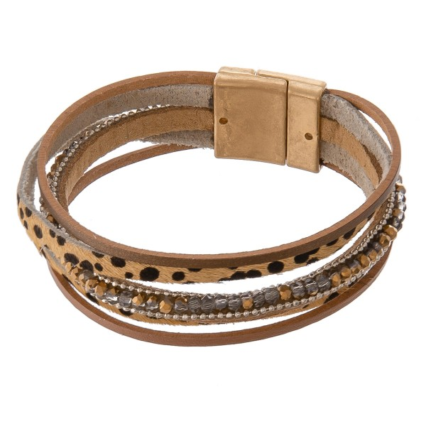 "Multi strand genuine leather cheetah print magnetic bracelet with beaded details.  - Magnetic closure - Approximately 3"" in diameter - Fits up to a 6"" wrist"