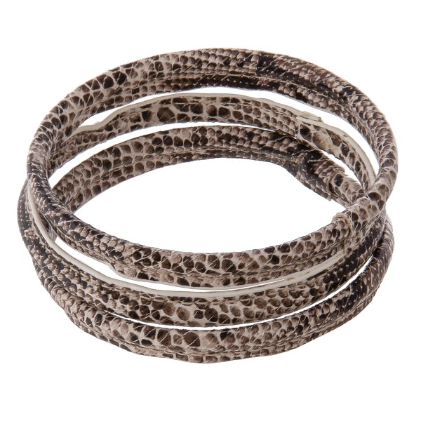 "Faux leather wrapped snakeskin bangle bracelet set of three.  - Approximately 3"" in diameter - Fits up to a 6"" wrist"