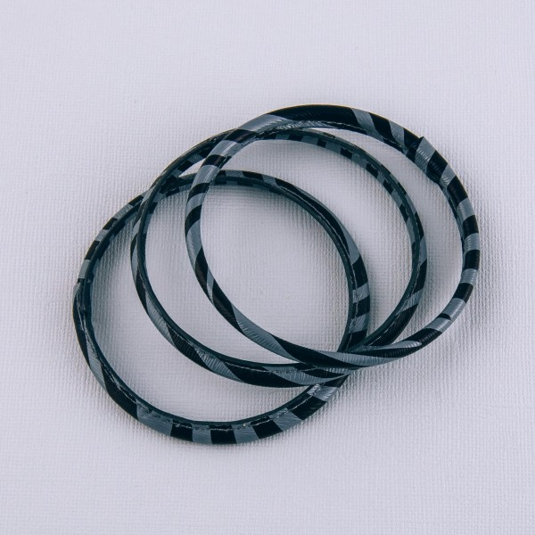 "Faux leather wrapped zebra print bangle bracelet set of three.   - Approximately 3"" in diameter - Fits up to a 6"" wrist"