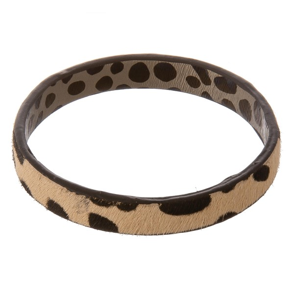 "Genuine leather double sided leopard print cowhide bangle bracelet.  - Approximately 3"" in diameter - Fits up to a 6"" wrist"