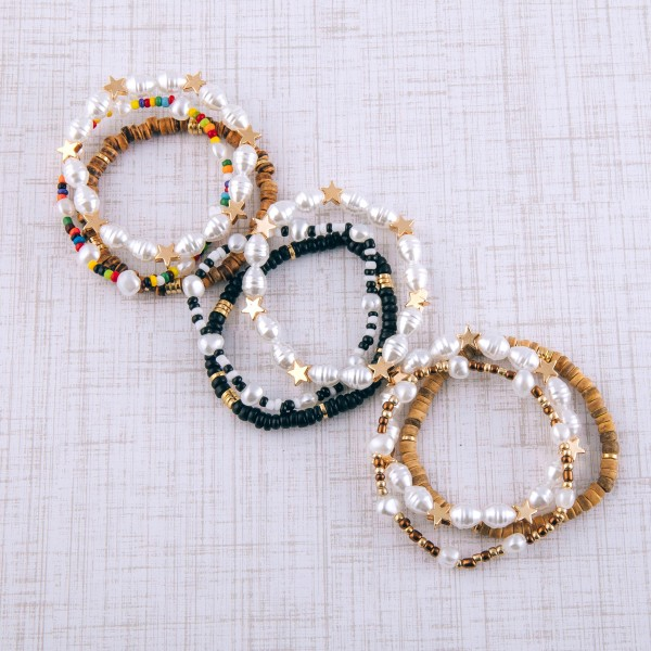 "Pearl beaded star stretch bracelet set of three.  - Approximately 3"" in diameter - Fits up to a 6"" wrist"