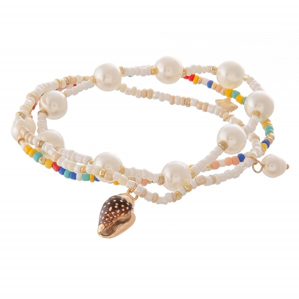 """Seed beaded pearl seashell stretch bracelet set of three.  - Approximately 3"""" in diameter unstretched - Fits up to a 7"""" wrist"""