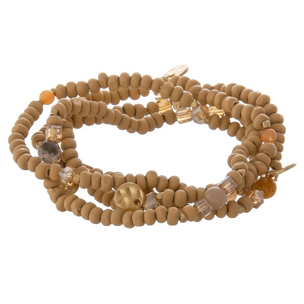 "Wood beaded stretch bracelet set with semi precious accents.  - 4pcs/pack - Approximately 3"" in diameter unstretched - Fits up to a 7"" wrist"