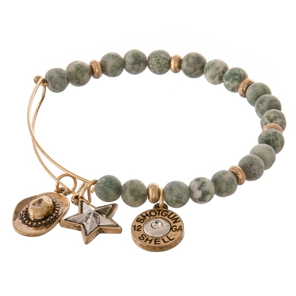 "Beaded bangle bracelet featuring western accents. -Natural stone inspired beads -Western themed charm accents include a cowboy hat, a lone star, and a shotgun shell  -Hook closure -Measures approximately 2.5"" in diameter -Fits up to a 6"" wrist"