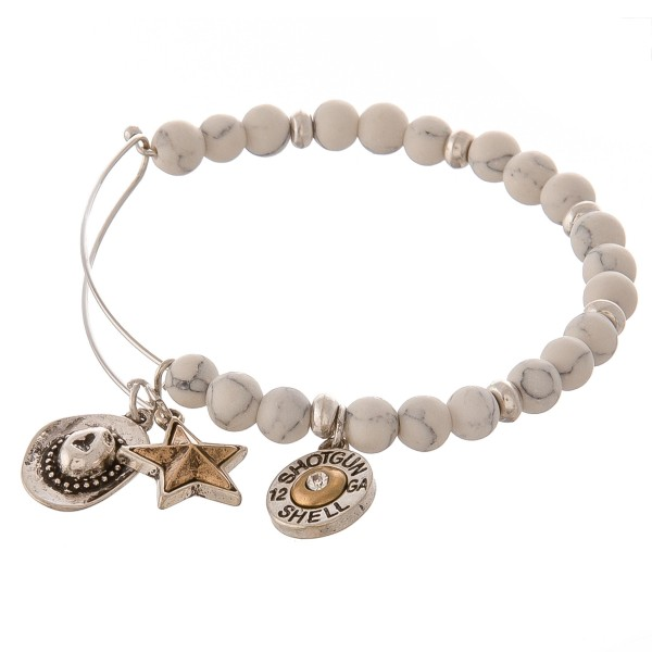 """Beaded bangle bracelet featuring western accents. -Natural stone inspired beads -Western themed charm accents include a cowboy hat, a lone star, and a shotgun shell  -Hook closure -Measures approximately 2.5"""" in diameter -Fits up to a 6"""" wrist"""