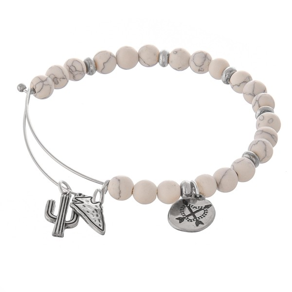 """Semi precious beaded western accented bangle bracelet.  - Natural stone inspired beads - Western charm accents include a cactus, arrowhead, and a crossed arrow design - Hook Closure - Approximately 2.5"""" in diameter - Fits up to a 6"""" wrist"""
