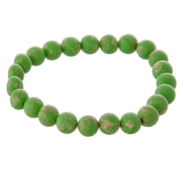 "Beaded stretch natural stone inspired ""Color Therapy"" bracelet -Color Therapy uses colors and their frequencies to heal and restore emotional balance  -Bracelet measures approximately 3"" in diameter  -Fits up to a 7"" wrist -Bead size is approximately 7.5mm in diameter"