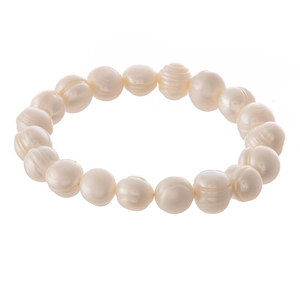 "Freshwater pearl beaded stretch bracelet.  - Pearl size approximately 10mm in diameter - Approximately 3"" in diameter unstretched  - Fits up to 7"" wrist"