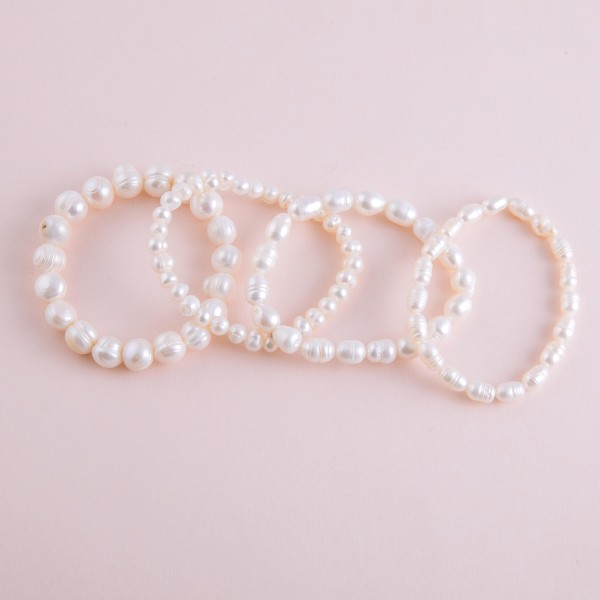 """Freshwater pearl beaded stretch bracelet.  - Pearl size approximately 10mm in diameter - Approximately 3"""" in diameter unstretched  - Fits up to 7"""" wrist"""