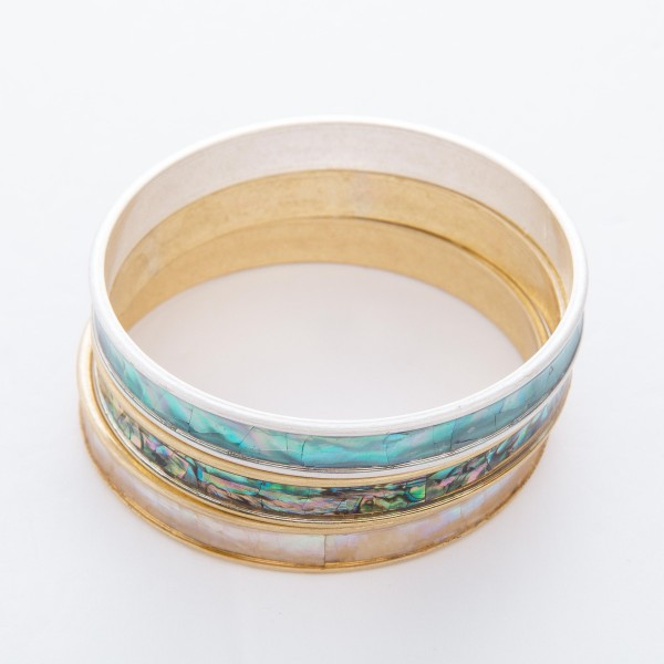 """Silver Mother of Pearl Coated Bangle Bracelet.  - Approximately 3"""" in diameter - Fits up to a 6"""" wrist"""