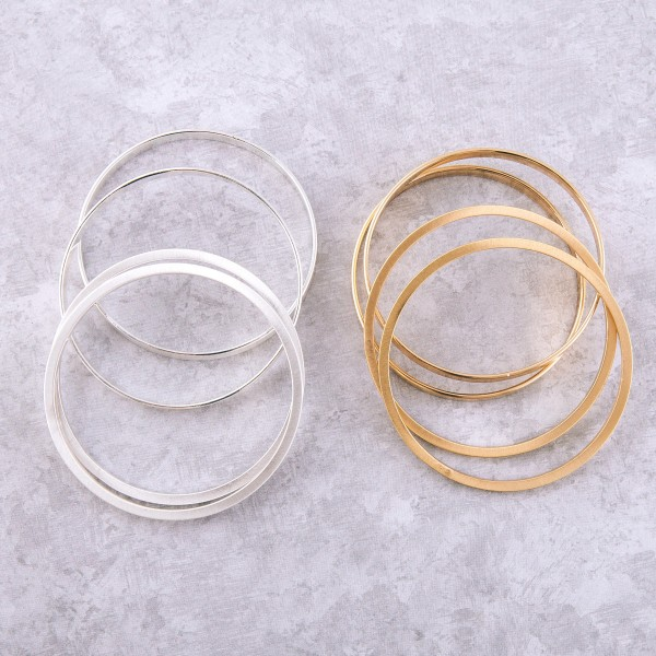 "Satin Gold stackable bangle bracelet set.  - 4pcs/pack - Approximately 3"" in diameter - Fits up to a 6"" wrist"