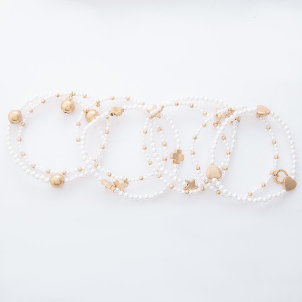 "Worn Gold Pearl Beaded CCB Stretch Bracelet Set.  - 2pcs/set - Approximately 3"" in diameter unstretched - Fits up to a 7"" wrist"