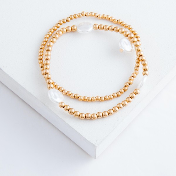 "Worn Gold Sphere Beaded Pearl Stretch Bracelet Set.  - 2pcs/set - Approximately 3"" in diameter unstretched - Fits up to a 7"" wrist"