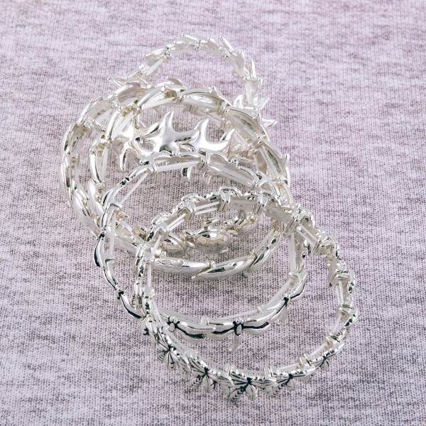 """Antique silver metal dragonfly stretch bracelet.  - Approximately 3"""" in diameter unstretched - Fits up to a 7"""" wrist"""