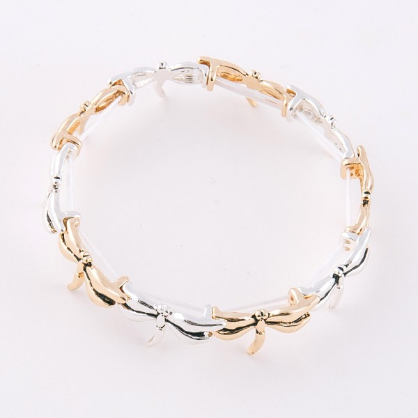 """Two tone metal dragonfly stretch bracelet.  - Approximately 3"""" in diameter unstretched - Fits up to a 7"""" wrist"""
