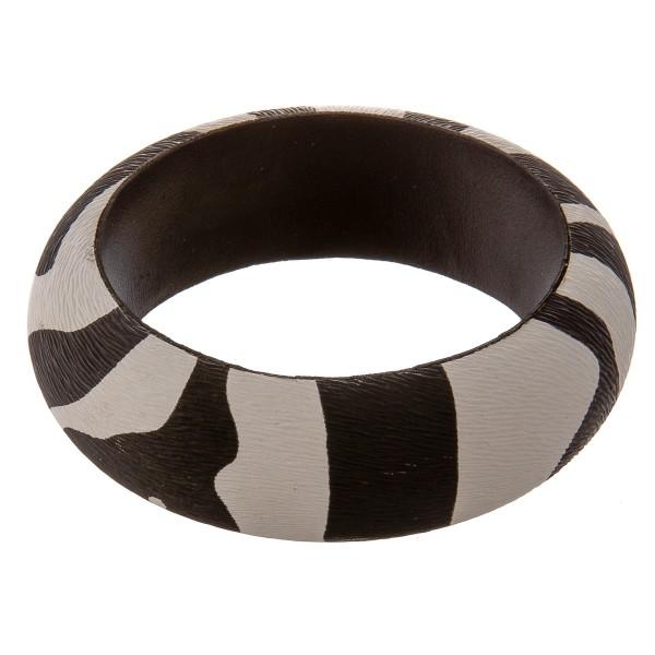 "Zebra print bangle bracelet.  - Approximately 3"" in diameter  - Fits up to a 6"" wrist"