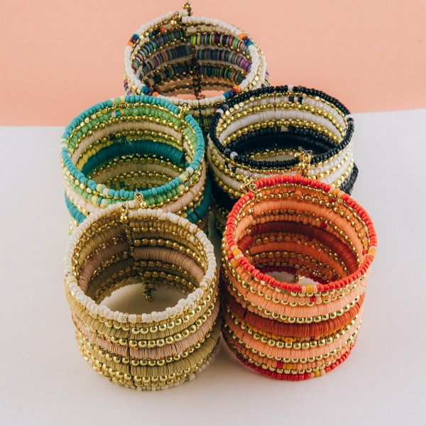 """Multi beaded bohemian bangle cuff bracelet.  - Approximately 2.5"""" in diameter unstretched - 2"""" in width - Fits up to a 7"""" wrist"""