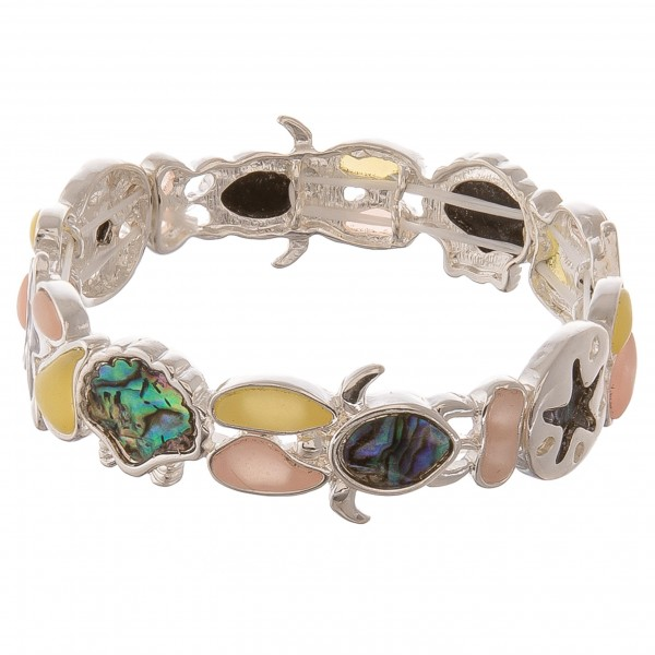 """Sea life glass abalone stretch bracelet.  - Approximately 3"""" in diameter unstretched  - Fits up to a 7"""" wrist"""
