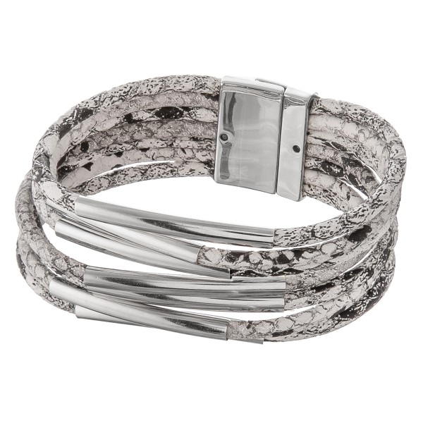 "Faux leather multi strand snakeskin magnetic bracelet with silver accents.  - Magnetic closure - Approximately 3"" in diameter - Fits up to a 6"" wrist"