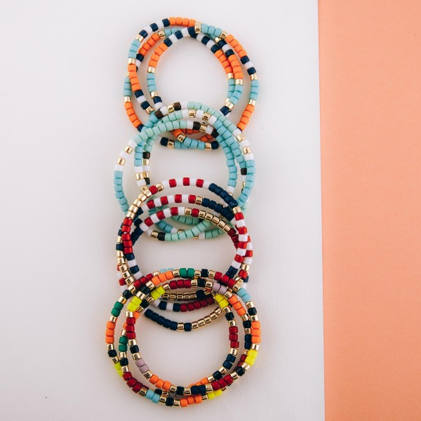 """Tube beaded stretch bracelet of three.  - Approximately 3"""" in diameter unstretched  - Fits up to a 7"""" wrist"""