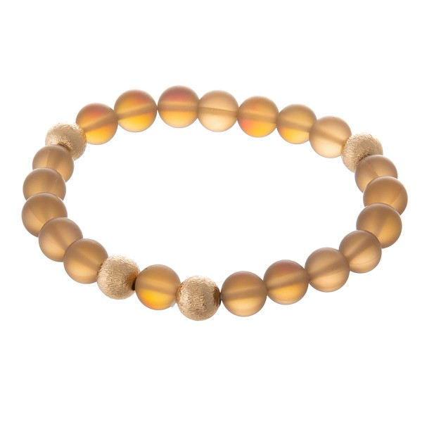 "Iridescent transparent beaded stretch bracelet with gold bead accents.  - Approximately 3"" in diameter unstretched - Fits up to a 7"" wrist"