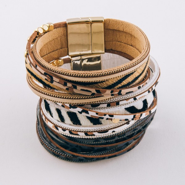 "Faux leather multi strand animal print magnetic bracelet with gold bead accents.  - Magnetic closure - Approximately 3"" in diameter - Fits up to a 6"" wrist"