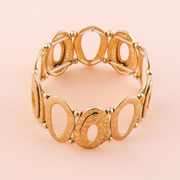 """Gold hammered cut out modern stretch bracelet.  - Approximately 3"""" in diameter unstretched - Fits up to a 7"""" wrist"""