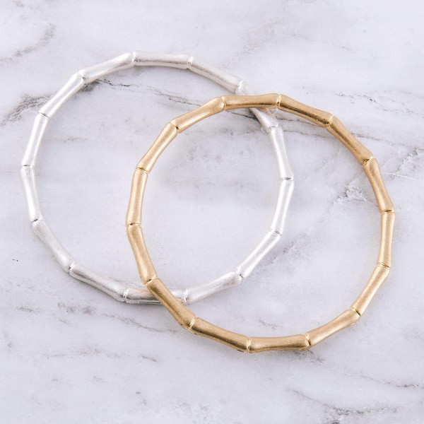"Thin metal bamboo bangle bracelet.  - Approximately 3"" in diameter - Fits up to a 6"" wrist"