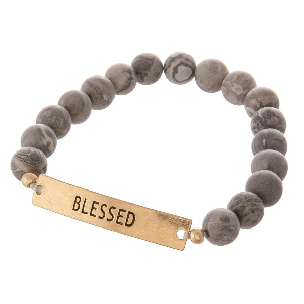 "Semi precious beaded ""Blessed"" engraved stretch bracelet.  - Approximately 3"" in diameter unstretched - Fits up to a 7"" wrist"