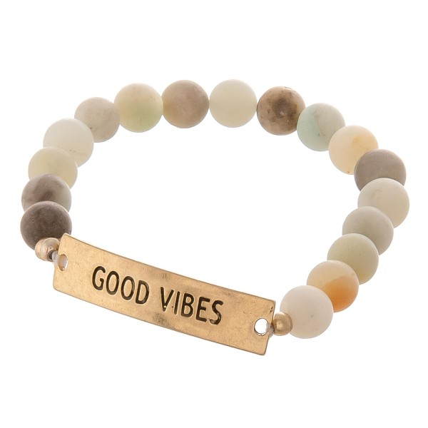 "Semi precious beaded ""Good Vibes"" engraved stretch bracelet.  - Approximately 3"" in diameter unstretched - Fits up to a 7"" wrist"