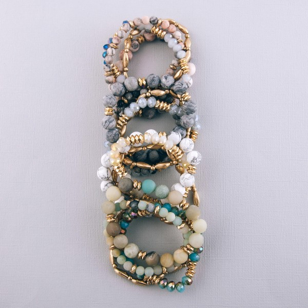 """Semi precious gold metal beaded stretch bracelet set.  - 4pcs/pack - Approximately 3"""" in diameter unstretched - Fits up to a 7"""" wrist"""
